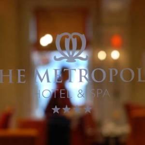 Metropole Hotel & Spa logo on glass window